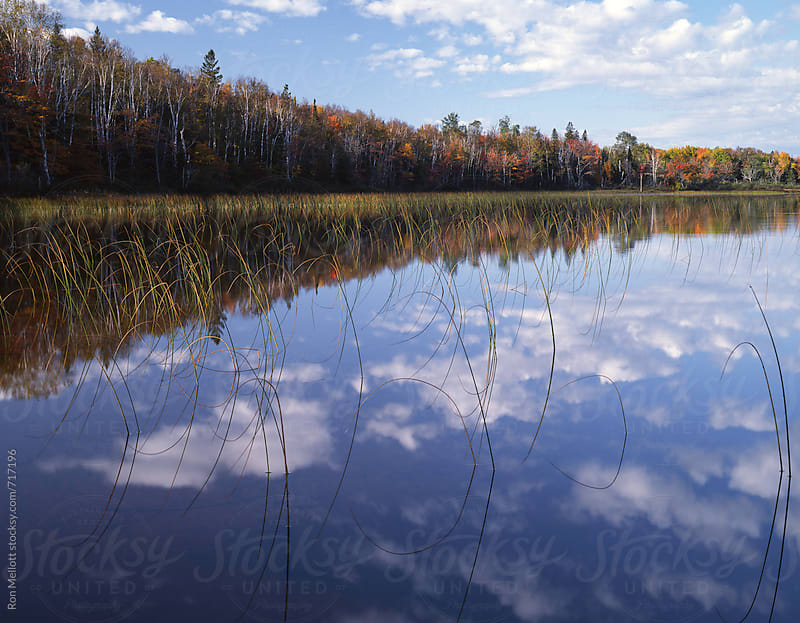 Canadian Lake in Quetico Provincial Park Ontario autumn cloud reflections by Ron Mellott for Stocksy United