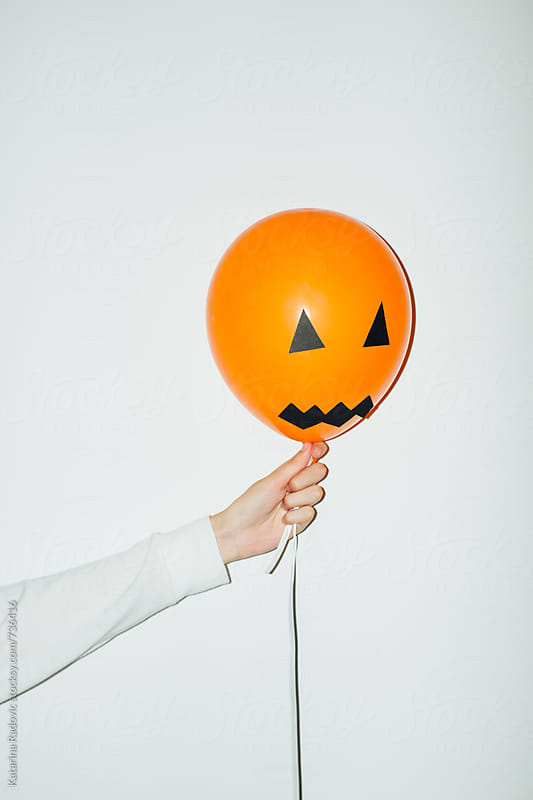 Woman Holding Halloween Party Balloon by Katarina Radovic for Stocksy United