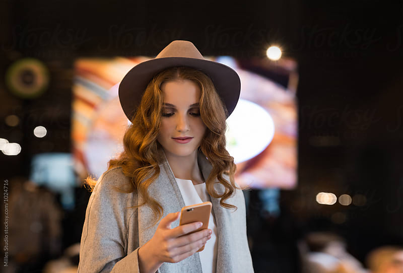 Young woman at cafe by Milles Studio for Stocksy United