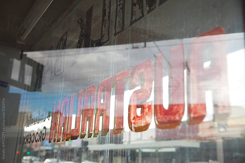 Signage from an abandoned old milk bar window in Australia by Natalie JEFFCOTT for Stocksy United