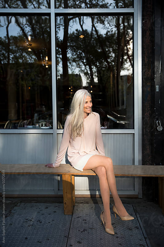 A  senior sitting on a bench by Ann-Sophie Fjelloe-Jensen for Stocksy United