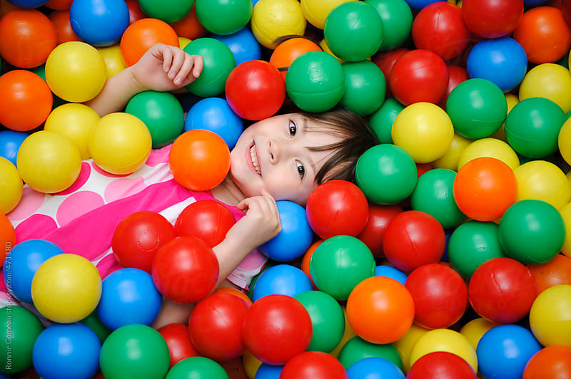 Ball Pit Kid by Ronnie Comeau for Stocksy United