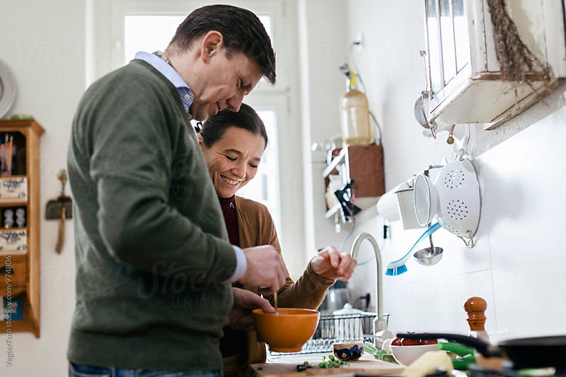 Mature cooking together. by VegterFoto for Stocksy United
