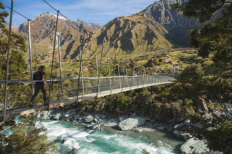 A woman hiking in New Zealand's Mount Aspiring National Park in spring. by Robert Zaleski for Stocksy United