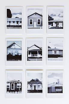 A collection of polaroids of houses by Amy Covington for Stocksy United