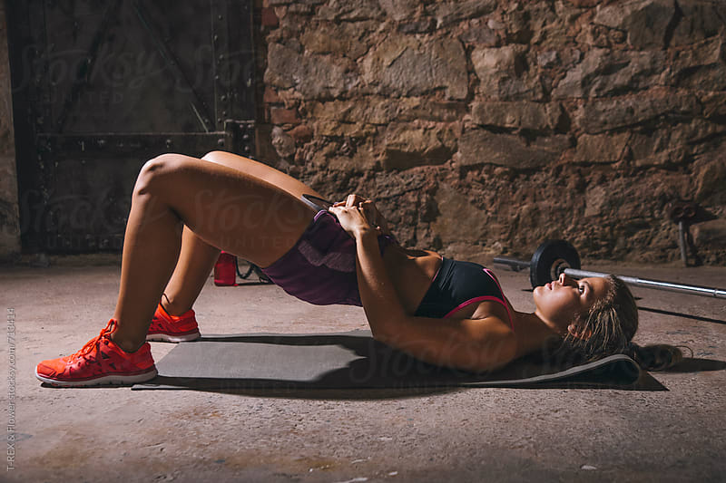 Girl training abs in the gym by Danil Nevsky for Stocksy United