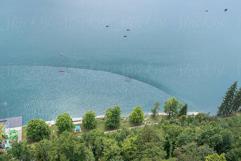 Lake from above with a separated swimming and recreational area by Lea Csontos for Stocksy United