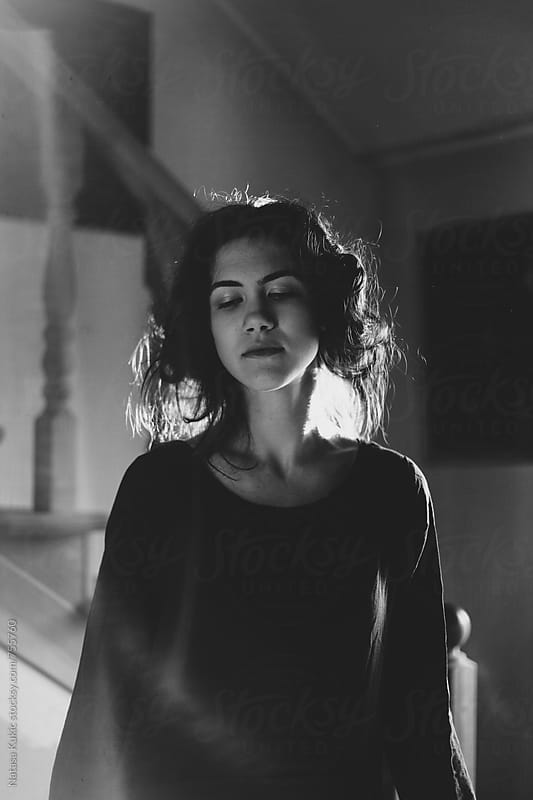 Darkish portraits of a girl in black and white by Natasa Kukic for Stocksy United
