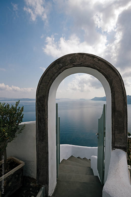 Archway leading to the caldera, Santorini by Paul Phillips for Stocksy United
