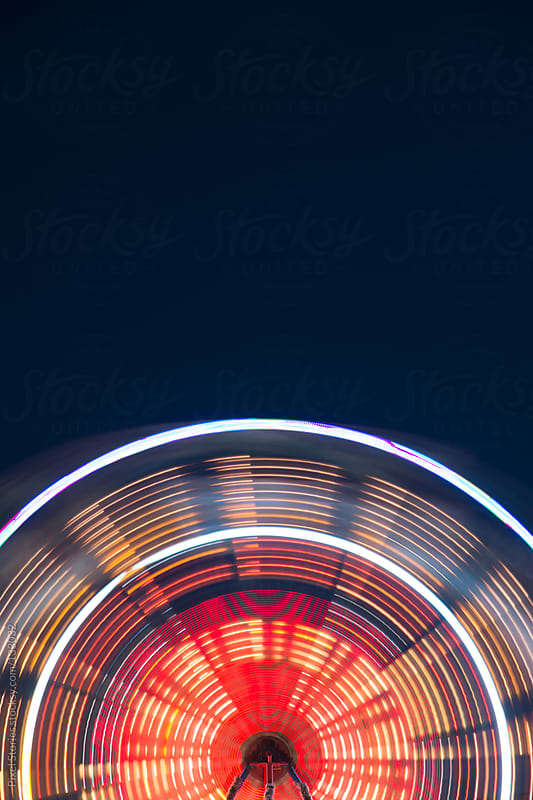 Carnival ferris wheel  by Pixel Stories for Stocksy United