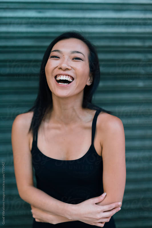 Asian Woman Smiling at Camera by Good Vibrations Images for Stocksy United
