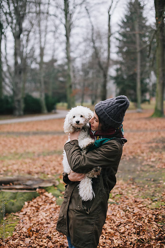 Woman and her dog having a good time outdoors by Marija Mandic for Stocksy United