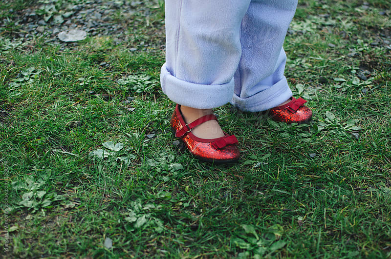 little girl's red glitter shoes by Margaret Vincent for Stocksy United