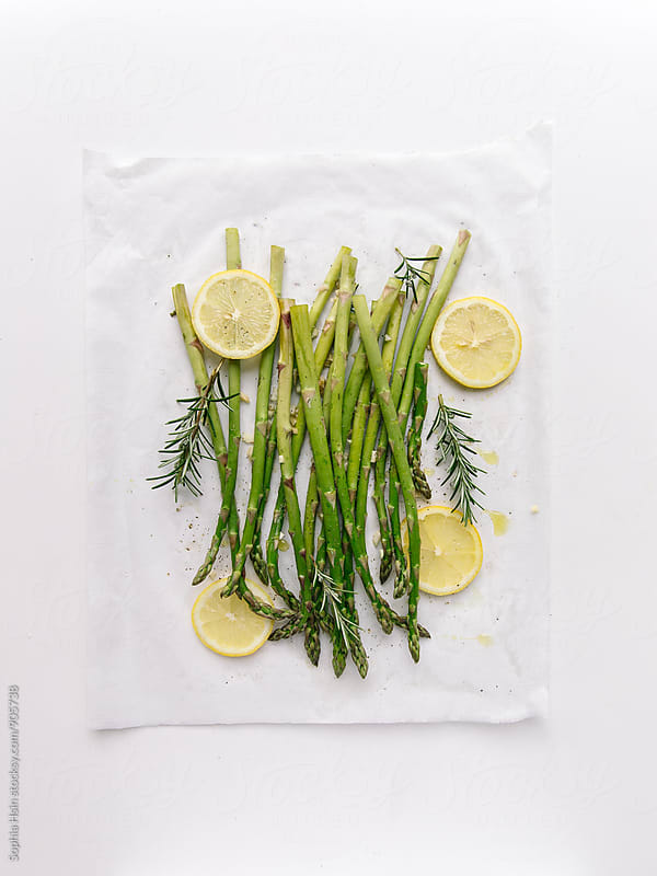 Roasted Asparagus, rosemary and lemon by Sophia Hsin for Stocksy United