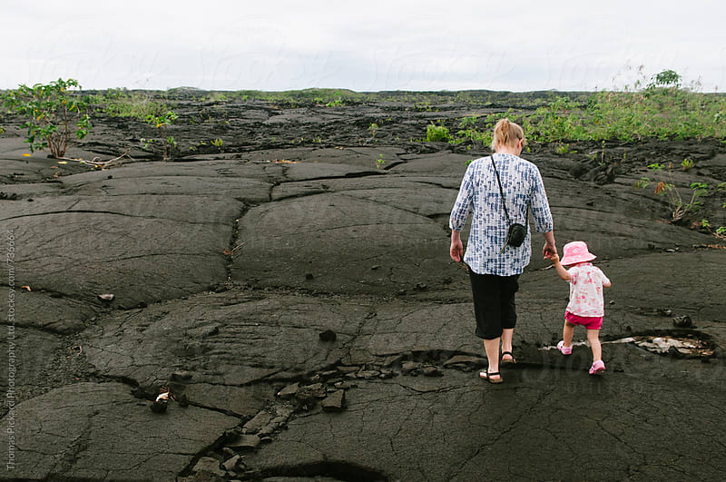 Girl toddler and mother walking over a lava field, Samoa. by Thomas Pickard Photography Ltd. for Stocksy United