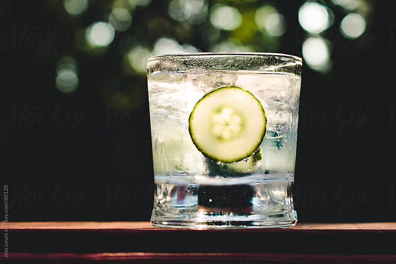 beverage with sliced cucumber and ice by Jess Lewis for Stocksy United