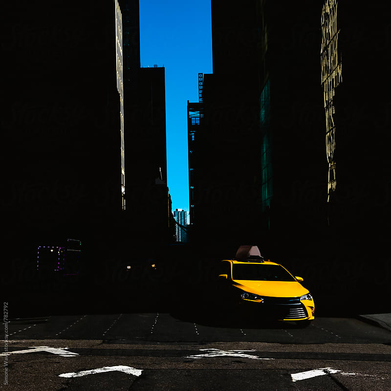 Cab in NY street  by Simone Becchetti for Stocksy United