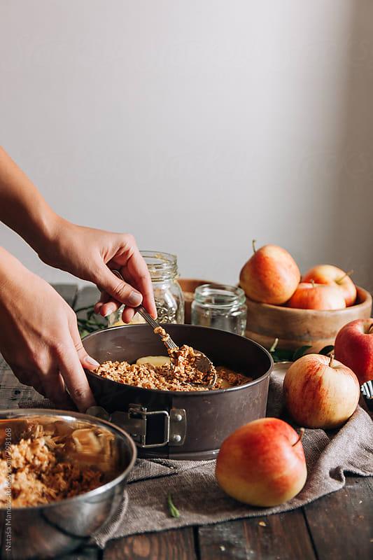 Making a crumble apple pie by Nataša Mandić for Stocksy United