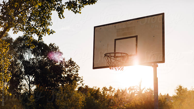 Basketball court in sunset by Dimitrije Tanaskovic for Stocksy United