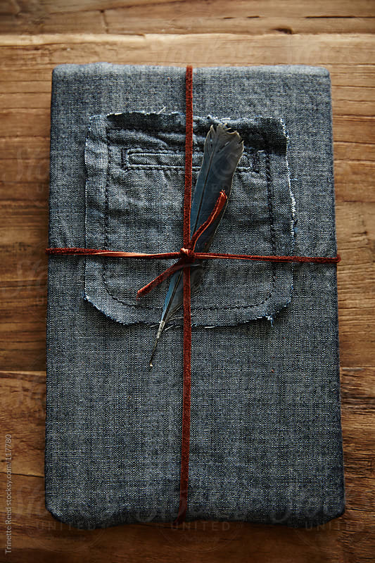 Hipster gift wrapped in denim and leather twine by Trinette Reed for Stocksy United