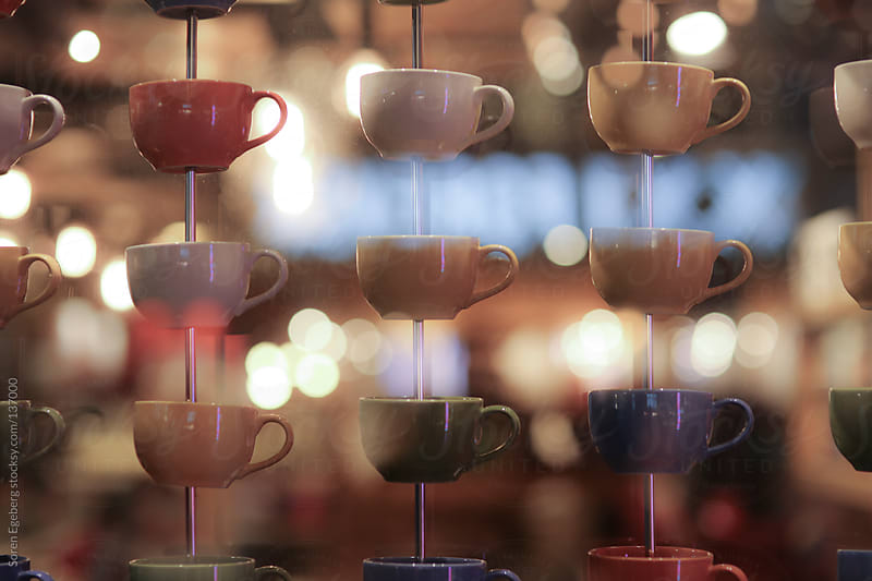 Multi colored coffee cups decoration with bright blurred backgro by Soren Egeberg for Stocksy United