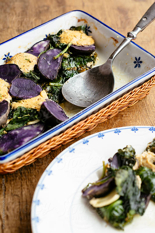 Spinach and Purple Potato Casserole by Harald Walker for Stocksy United