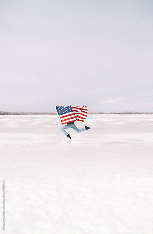 young man with USA flag  by Alexey Kuzma for Stocksy United