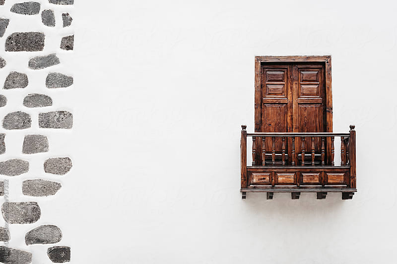 Wooden window door and balcony in a white wall. La Palma, Canary Island. by Liam Grant for Stocksy United