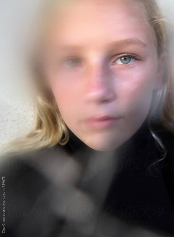 Untraditional Portrait Of Teenager With Beautiful Eyes by Dina Giangregorio for Stocksy United