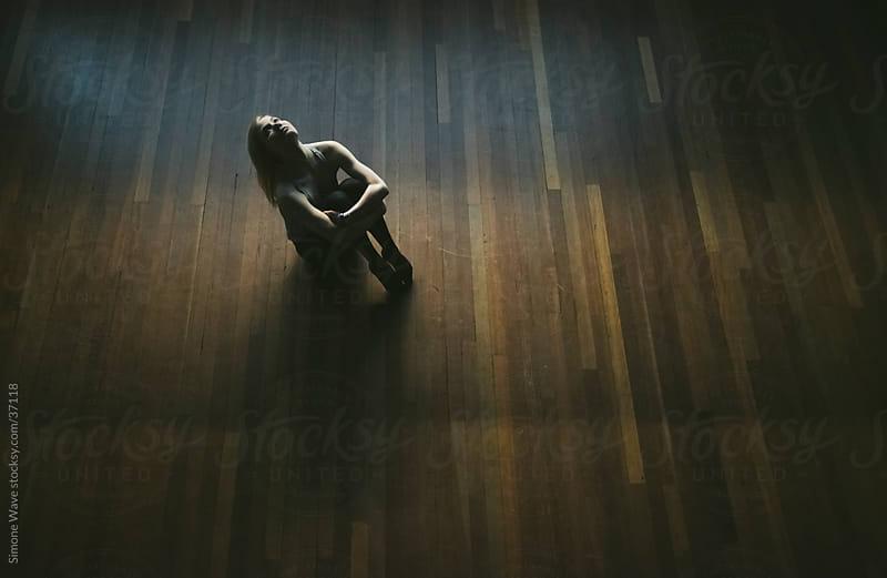 Dancer sitting on the floor by Simone Becchetti for Stocksy United