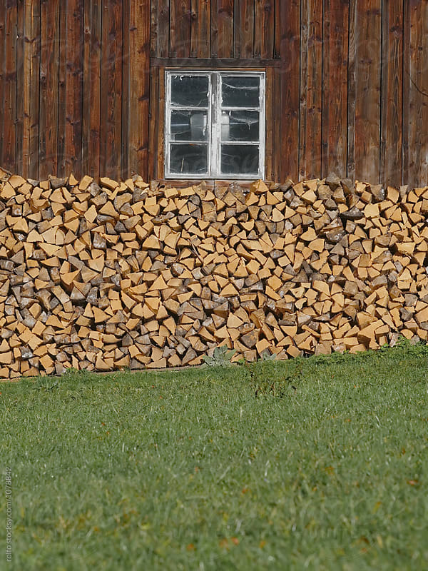 firewood pile up wooden wall by rolfo for Stocksy United
