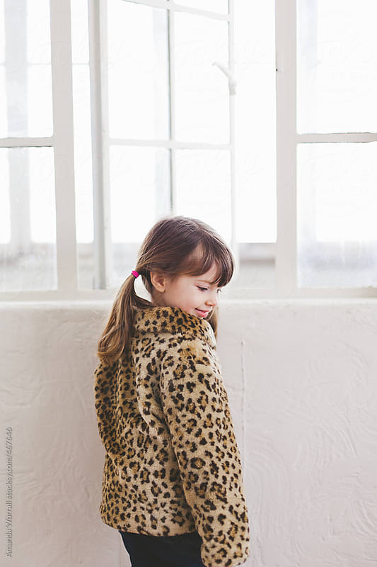 Young girl with leopard coat by Amanda Worrall for Stocksy United