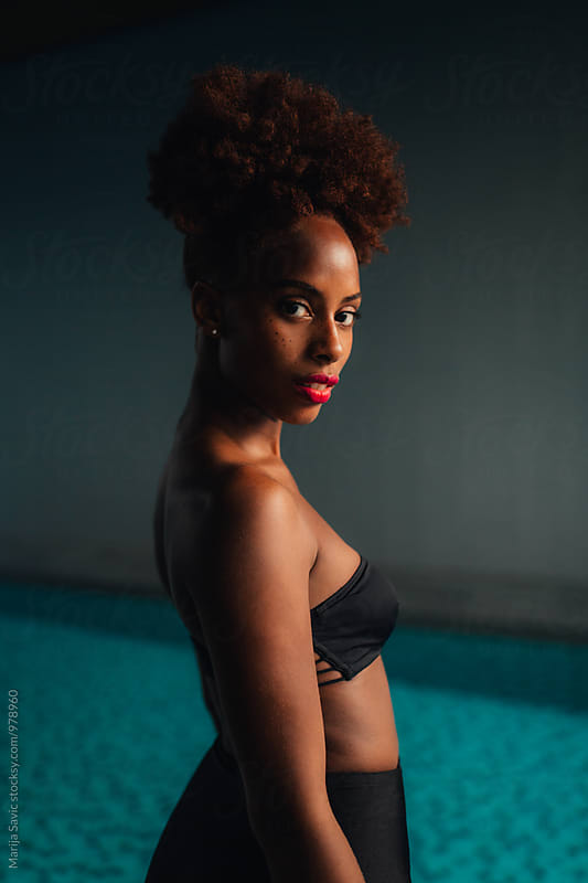 Black Woman by the Pool by Marija Savic for Stocksy United