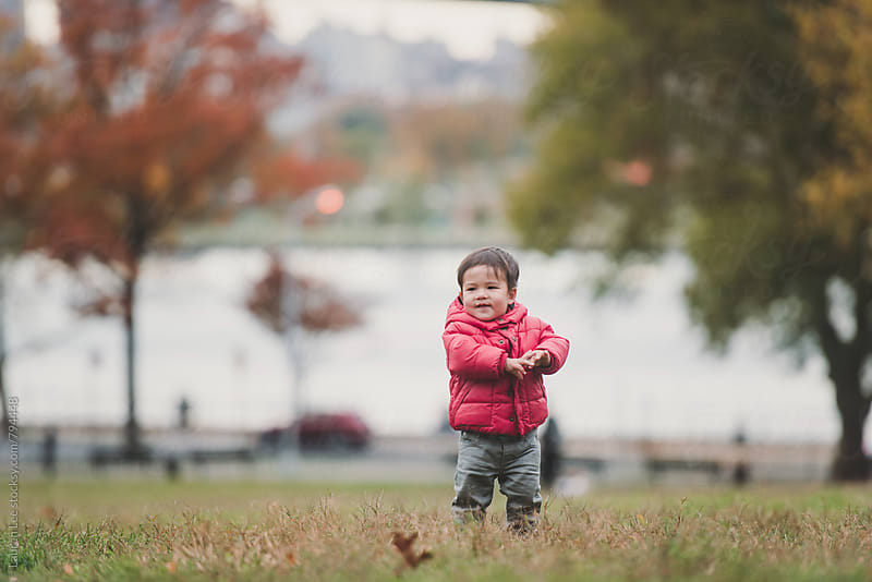 Happy little boy playing in the park by Lauren Naefe for Stocksy United