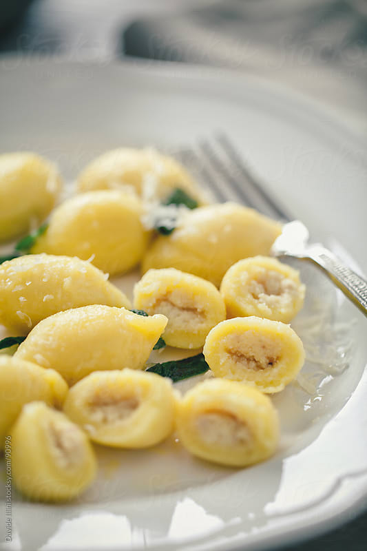 Potato Dumplings Stuffed by Davide Illini for Stocksy United