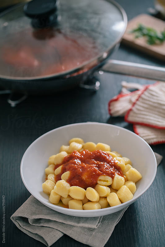 Gnocchi with tomato sauce. by Davide Illini for Stocksy United