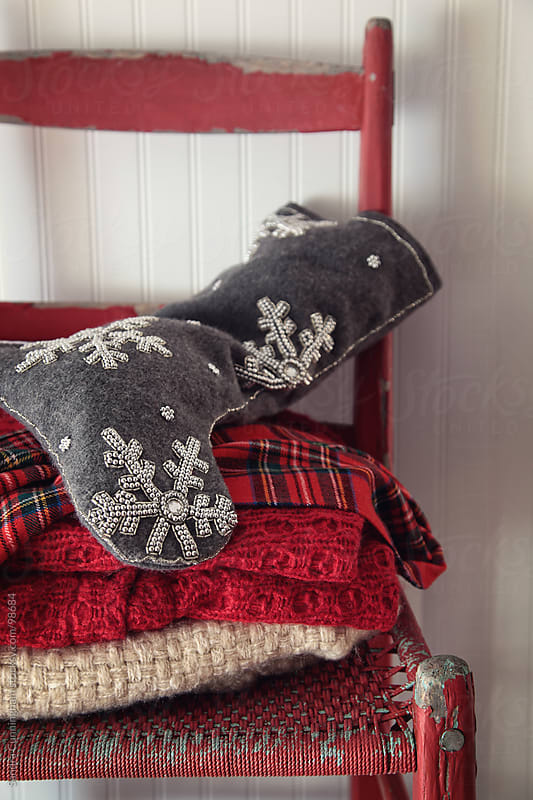Christmas stocking on old red chair by Sandra Cunningham for Stocksy United