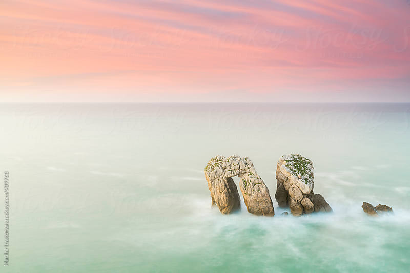 Pastel sunset on a beautiful coast by Marilar Irastorza for Stocksy United