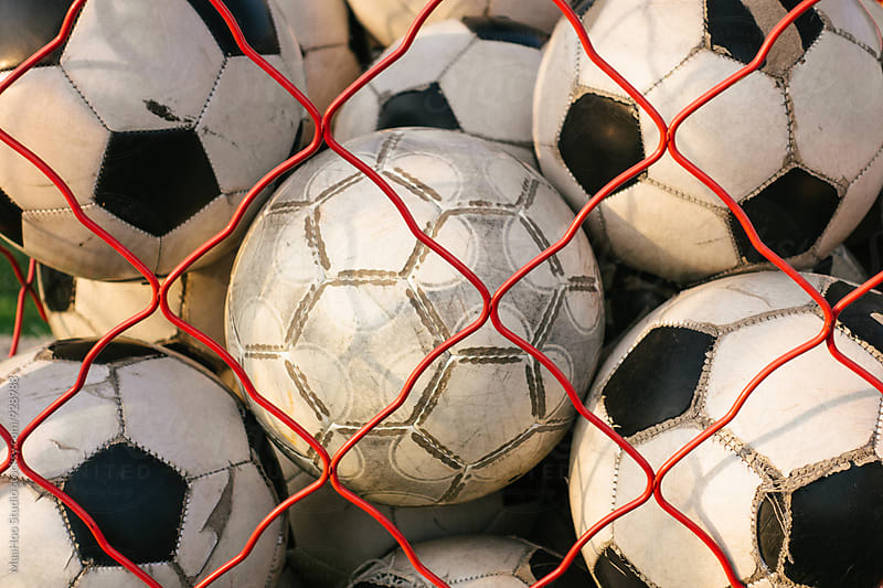 Net full of footballs by Maa Hoo for Stocksy United