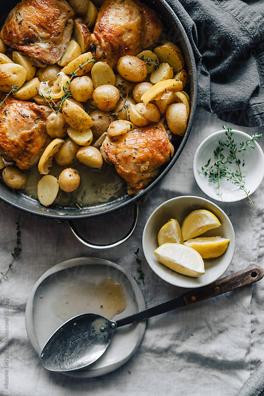 chicken and potatoes by Melanie DeFazio for Stocksy United