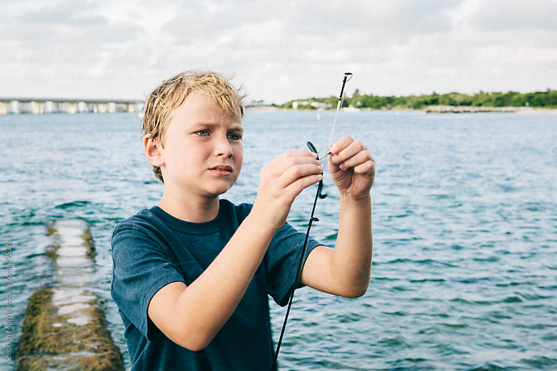 Boy Baiting Hook for Fishing by Stephen Morris for Stocksy United
