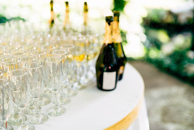 Wedding reception table with champagne glasses by Pixel Stories for Stocksy United