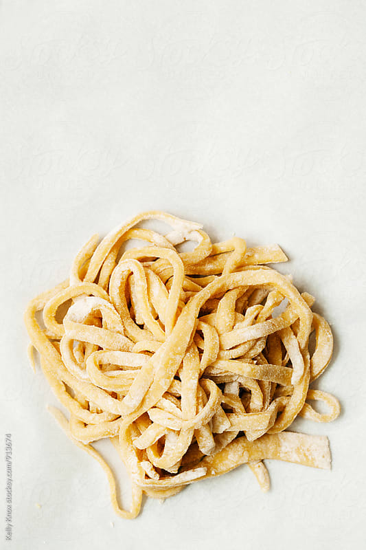 small pile of uncooked, homemade pasta by Kelly Knox for Stocksy United