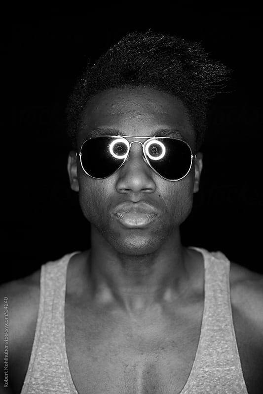 Black man with sunglasses by Robert Kohlhuber for Stocksy United