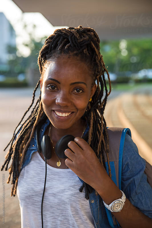 Outdoor portrait of beautiful African American young woman  by Jovo Jovanovic for Stocksy United
