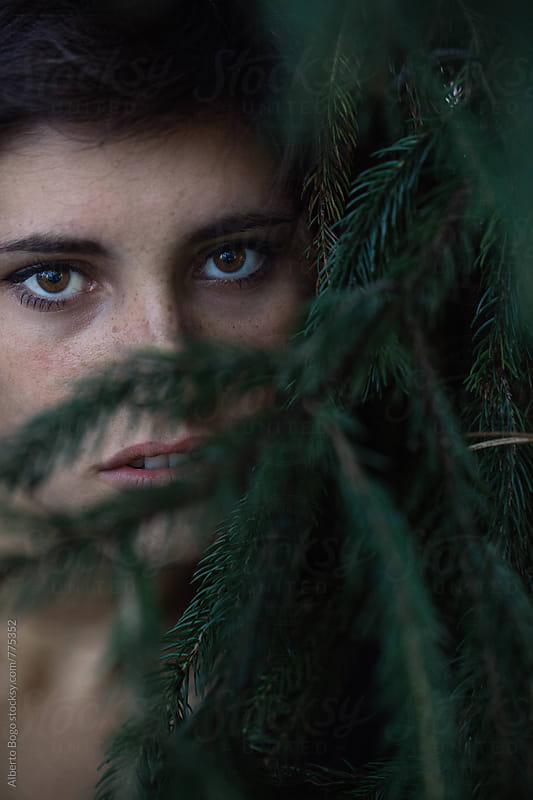 Portrait of a beautiful young woman in the nature by Alberto Bogo for Stocksy United