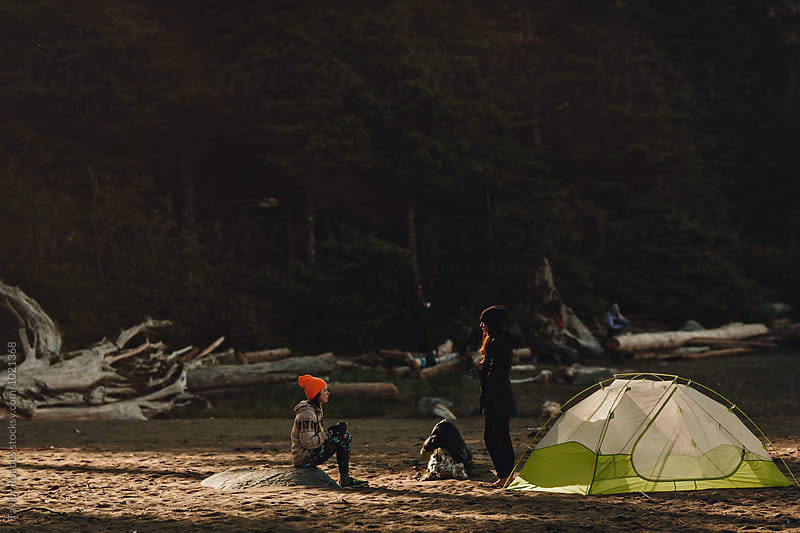 Camping in Sun Flare on Beach  by Taylor Roades for Stocksy United