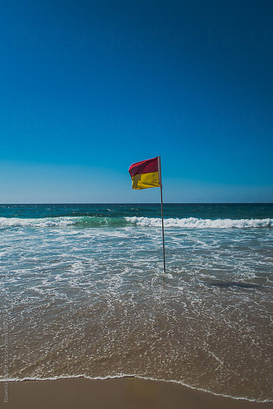 Surf Lifesaving Flags on Surfers Paradise Beach by Rowena Naylor for Stocksy United