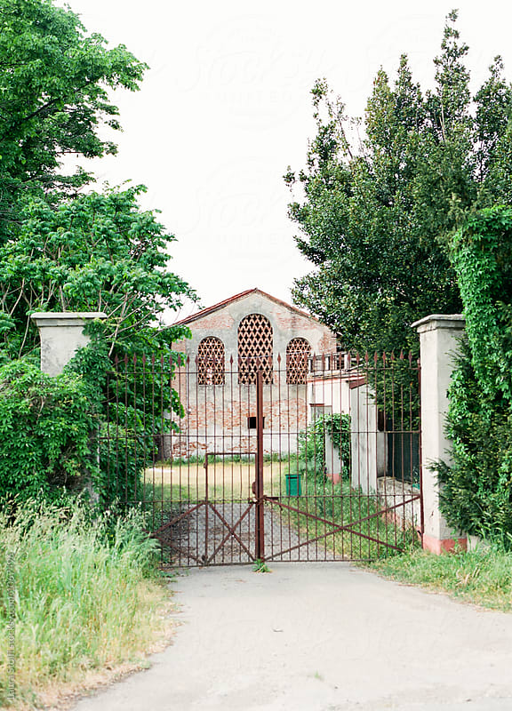 Gate to abandoned ancient farm in northern Italy by Laura Stolfi for Stocksy United