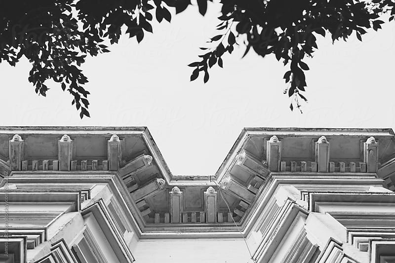 Looking up at an ornate Victorian roofline by James Jackson for Stocksy United